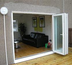 White-Upvc-Bi-Folding-Doors-1-250x225